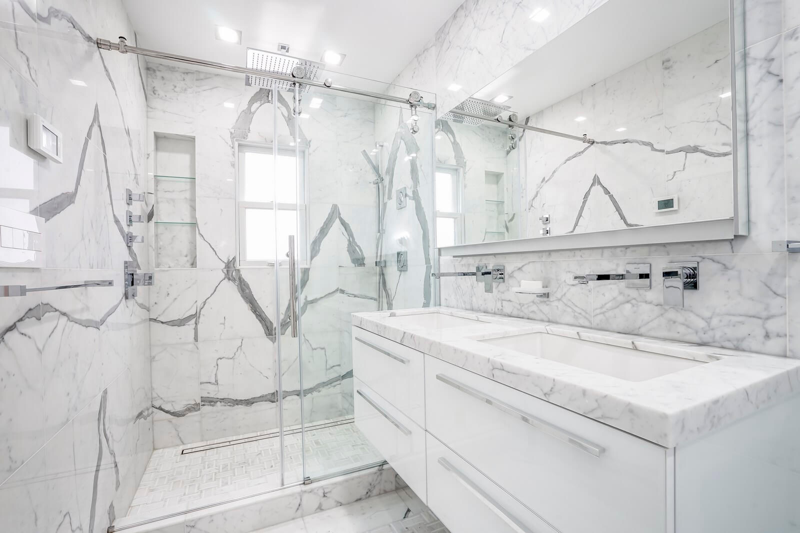 The entire space of this bathroom is filled with light and sparkle thanks to original interior design techniques. The bathroom does have a lot of sparkling surfaces. Besides, our interior designers have placed some large mirrors here. The elegant windows also add some light to the interior. In the evening and at night, the room is filled with artificial light emitted by several large, beautiful pendant lamps. Don't miss the chance to elevate your bathroom interior design by contacting our best interior designers as soon as possible!
