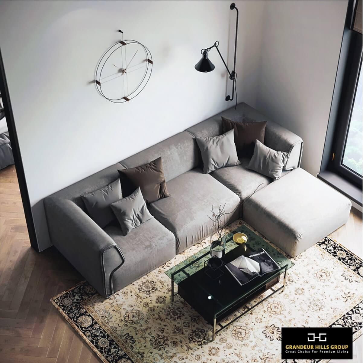 The living room is decorated in gray tones. All pieces of furniture are in perfect harmony with both each other and all surfaces of the living room – the gray walls and the ceiling. The living room looks quite spacious thanks to the correct arrangement of furniture and a small amount of furniture pieces in the room. An elegant rug in the center of the living room unites the color scheme, making the living room beautiful and fully functional. Dreaming of the same interior? Then rely on the best Grandeur Hills Group interior designers who are bound to make your living room stand out!